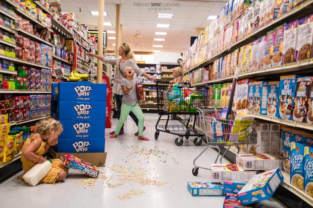 Mom_in_grocery_store_with_kids_throwing_cereal_and_eating_on_floor